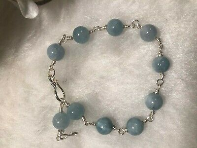 Beautiful bashful blue beaded  stone bracelet with silver plated wire.