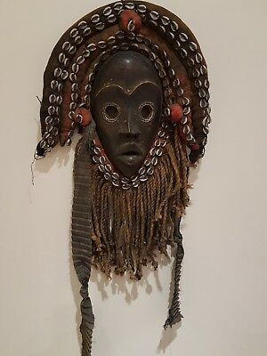 Outstanding African wood Dan Gunyege mask. Rare and fine example.