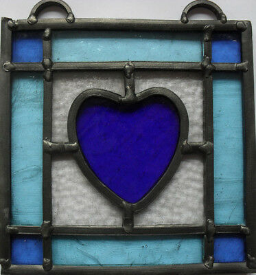 stained glass panel with reclaimed glass .