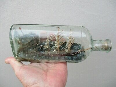 An Antique Hand Painted Folk Art Ship in a Bottle c1880/1900
