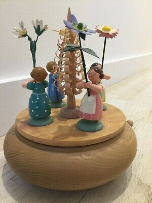 Genuine Erzgebirge musical box carousel with flower children (Blumenkinder)