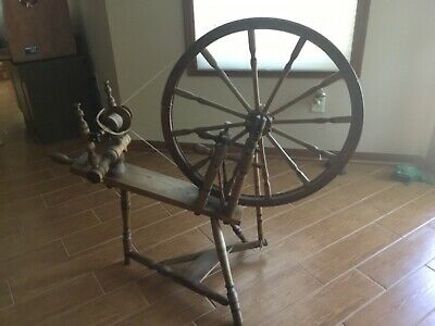 antique spinning wheel, works. Local pickup only