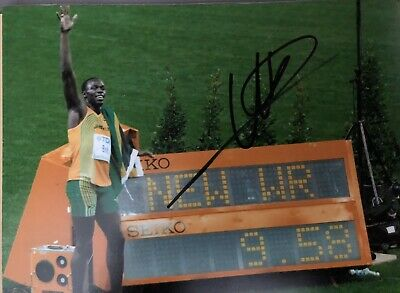 Usain Bolt Signed 10X8 PHOTO World Record COA