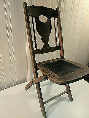 Antique Folding Brown Chair-Wood and sewn fabric Construction.