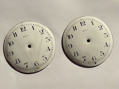 Old clock part Two cracked porcelain dials