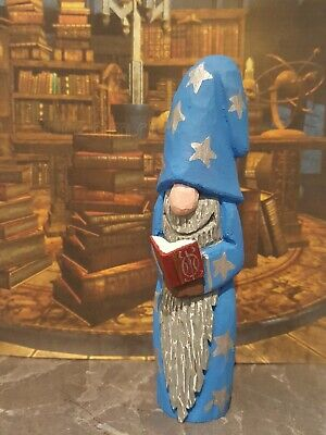 Hand carved and hand painted wooden wizard with spell book