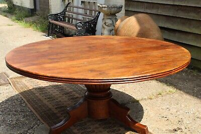 An Antique Solid Oak 10 Seater Round Dining Table