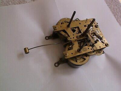 MECHANISM  FROM AN OLD  NEW HAVEN WALL CLOCK working order