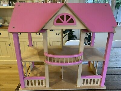 Wooden Doll's House With Wooden Furniture And Doll Family