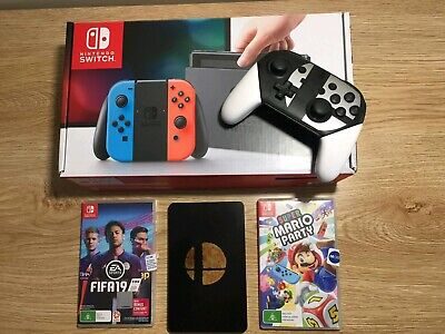Nintendo Switch Neon Bundle 32 GB Console plus 2 X controllers and games.