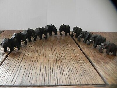 Ten Vintage solid hard wood miniature Carved Elephants some with tusks and eyes