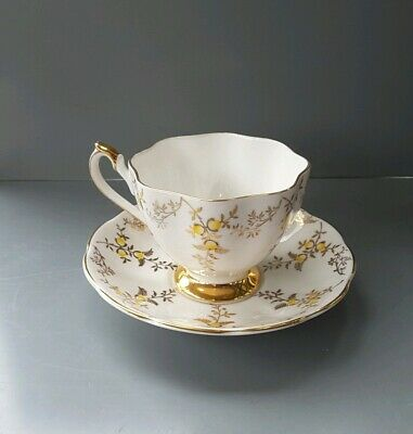 Queen Anne Fine Bone China Cup And Saucer White Guilt And Yellow