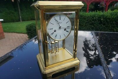 A Large Four glass mantel carriage clock by Angelus