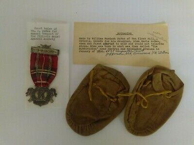 1915 Illinois Saint Andrew Society guest badge and handmade moccasins provenance
