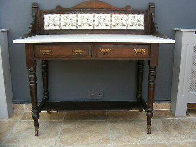 Victorian marble top washstand with tiled back and castor feet