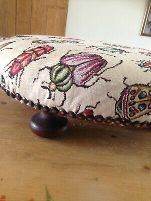 Small, round, Victorian footstool. Upholstered in Linen, 4 bun feet.