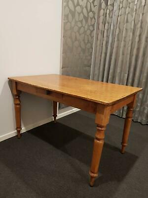 Antique kauri pine table with turned legs
