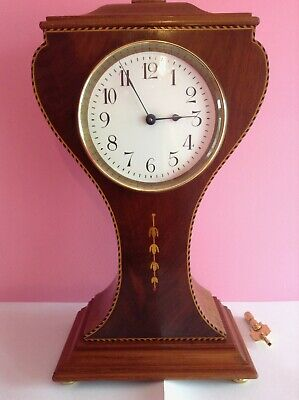 Antique French balloon clock ( keeps accurate time )