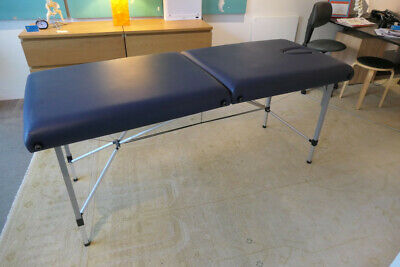 Folding Portable Wood Massage Table - Light but strong in easy clean dark blue.