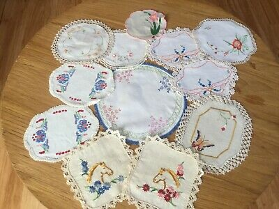 12 small Vintage hand embroidered Doilies