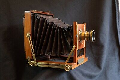 Half plate bellows camera 1900s mahogany & brass working order. Lens & 3 slides.