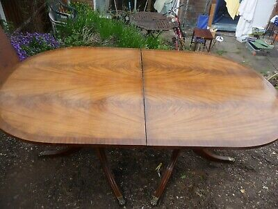 solid extendable mahogany dining table