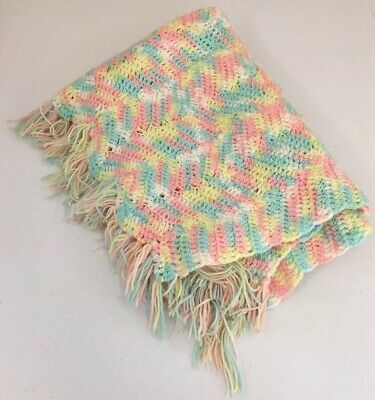 Soft Cuddly White, Blue, Pink, and Yellow Handmade Baby Crocheted Blanket.
