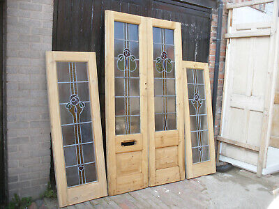 Pair of reclaimed stripped pine, stained glass double doors with side panels