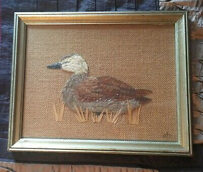 Anne Howe Framed Duck bird art made with dried leaves and feathers on burlap