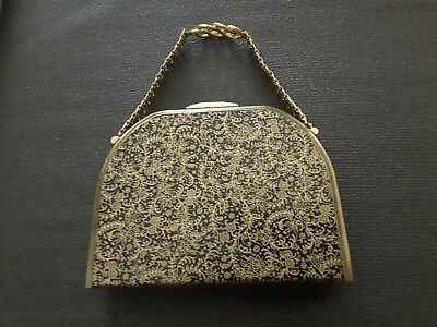 STRATTON ENGLAND 1950's BRASS? & BLACK BAG WITH COMPACTS, LIPPY, MIRROR, COMB.
