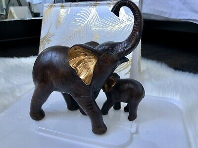 Elephant figurine. 2 in 1 Handmade Wood Piece With Beautiful Gold Paint Detail.