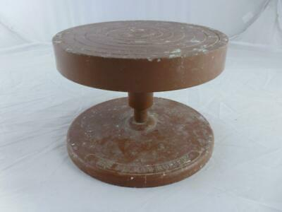 Small cast metal potters' turntable. Wheel