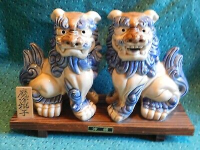 Chinese Blue/Beige Porcelain Foo Dogs, Growling, Snarling On Wooden Stand