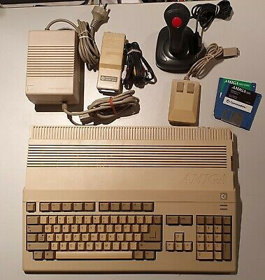 Commodore Amiga 500 + A520 Mod + Mouse + Joystick + Container of 90 Floppy Discs