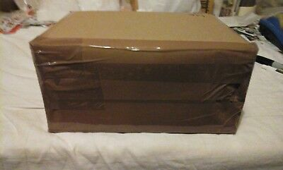 Box of World Kiloware 0.974Kg ON paper with high/er values.