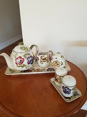 Ceramic set of Pansy Teapot sugar creamer and sand p with matching trays