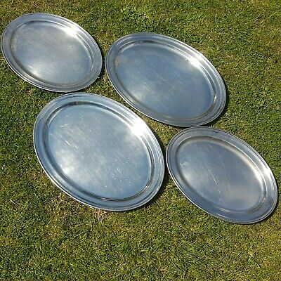 Four Large Antique Stainless Steel Meat Plates