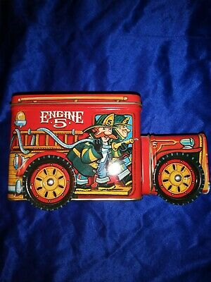 Vintage Fire Truck Tin Bank Collectible w/ moving wheels In Mint Condition