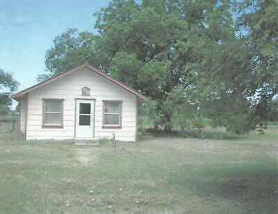 One floor, 2 bedroom house + 5 registered building lots in Quanah, Texas