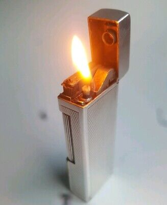 Dunhill Auto-rollalite petrol lighter silver plated good workong condition