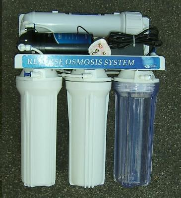 Reverse osmosis system with booster pump and DI water fed pole pure water.