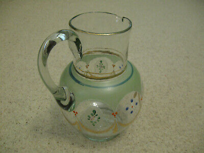 Antique enamel]ed glass jug
