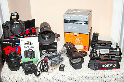 Canon EOS Rebel T3i 18.0MP Digital SLR Camera with battery grip, 4 lenses & more