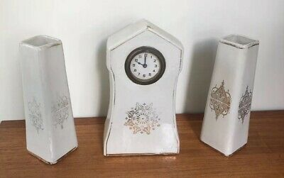 Antique Porcelain Mantle Clock and Matching Vases.  M.W. (age unknown)