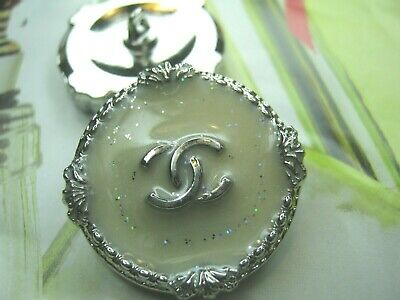 CHANEL 4 BUTTONS  silver off white  COLOR METAL 24 mm , 1 inch  with  cc logo