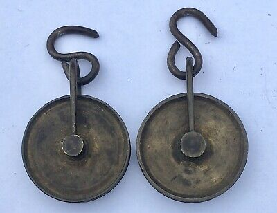 ## Pair Of Antique Grandfather/ Longcase Clock Pulleys