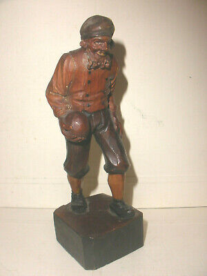 Fine Antique Carved Wood black forest man with ball or pirate cannonball figure