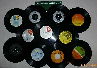 """A 7"""" vinyl collection of 12 Christmas singles in White Paper Sleeves"""