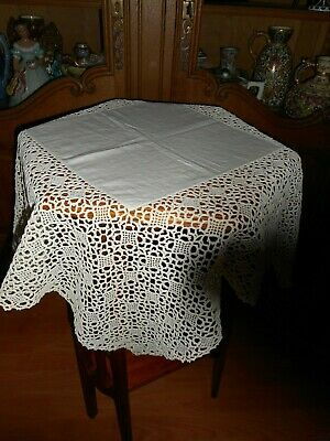 Antique white table cloth with deep crochet.