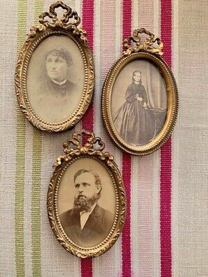 Small Victorian oval picture frames  with bow detail and  antique photos